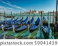 Gondola boats in Venice near Piazza San Marco, St Mark's Square with 50041439