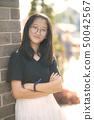 portrait of pretty asian teenager wearing eye 50042567