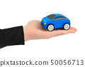 Hand and toy car 50056713