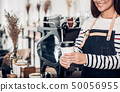 Barista serving take awary coffee cup at 50056955