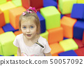 portrait of girl on a soft cubes 50057092