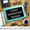 Career Development Services Handwritten on Small Chalkboard. 3D. 50059118