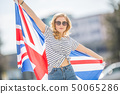 Attractive happy young girl with the flag of the 50065286