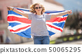 Attractive happy young girl with the flag of the 50065295