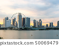 Singapore flyer cityscape on marina bay and sunset 50069479