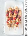 Grilled chicken skewers on the white plate 50071704