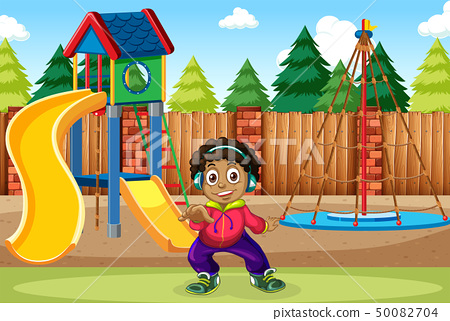 A boy listen to music at the playground 50082704
