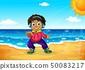 A boy at the beach 50083217