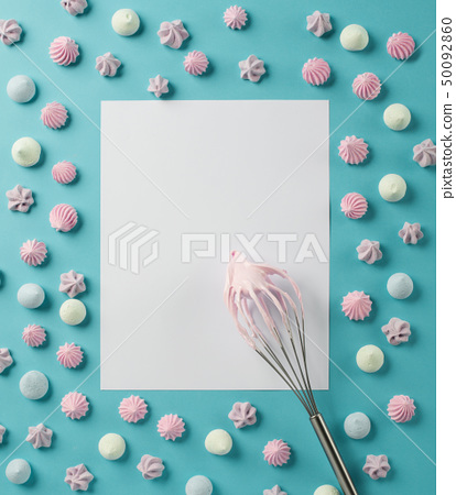 Whipped egg whites and colorful meringue cookies 50092860