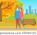 Man and Woman Walking Together in Autumn Park 50094191