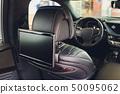 Car inside. Interior of prestige luxury modern car. Three TV displays for passenger with media 50095062