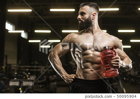 Handsome strong athletic muscles men drink water 50095904