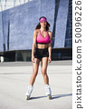 Young attractive woman roller skating in the Forum 50096226