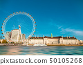 London Eye near County Hall in summer view from Thame river boat cruise. 50105268