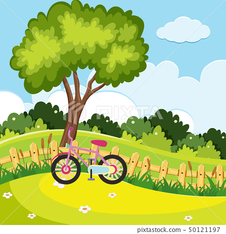 Park scene with pink bike by the fence 50121197
