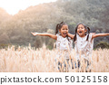 Two asian child girls play in the barley field 50125158