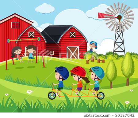 Children playing swing and riding bicycle on the 50127042