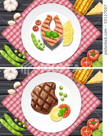 Salmon and beef steak on the plates 50127087