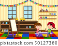 Two kids painting in the classroom 50127360