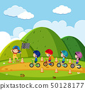 Kids racing bike in the park 50128177