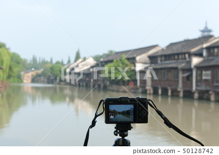 Taking photo of Chinese village 50128742