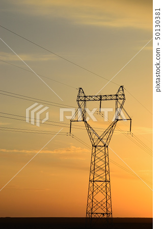Telegraph pole at sunset 50130381