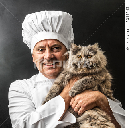 mad cook with his cat 50132434