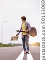 girl with a guitar hitch-hiking 50133069