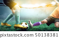Football player woman in orange jersey sliding 50138381