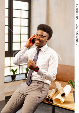 Positive cheerful man speaking with his client 50146074