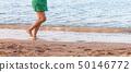 Leg of woman running on sand beach. summer 50146772