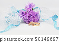 gold wedding engagement rings with white ribbons  50149697