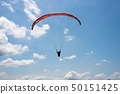 colorful paragliding under blue sky 50151425