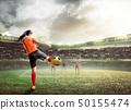 Asian football player woman in orange jersey 50155474