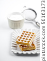 Belgium waffers with sugar powder on ceramic plate 50163173