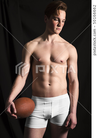 American football male player isolated black 50166662