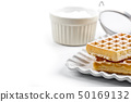 Belgium waffers with sugar powder on ceramic plate 50169132