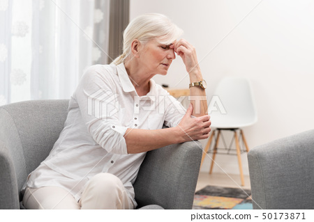 Older woman has a headache. 50173871