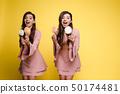 lollipop, twins, women 50174481