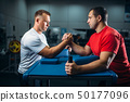 Two arm wrestlers on starting position, wrestling 50177096