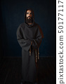 Monk in black robe with hood, religion 50177117