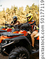Two atv riders before the trip in summer forest 50177119