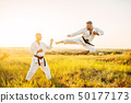 Karate fighters, kick in flight on training fight 50177173