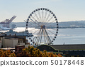A ferry and waterwheel next to Elliott Bay in Seattle 50178448