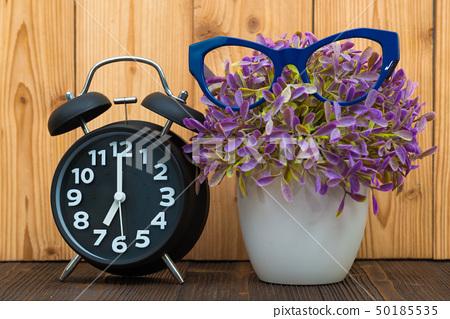 Little tree in white vase with vintage alarm clock 50185535