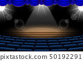 white brick wall on the stage with blue chairs in  50192291