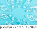 Many empty plastic bottles on blue background. 50192849