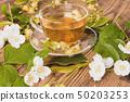 Cup of tea linden jasmine on wooden background 50203253