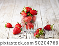 Organic red strawberries in glass on rustic wooden 50204769