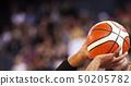basketball player shooting three pointer 50205782